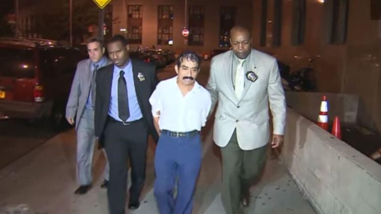 Conrado Juarez escorted by officers