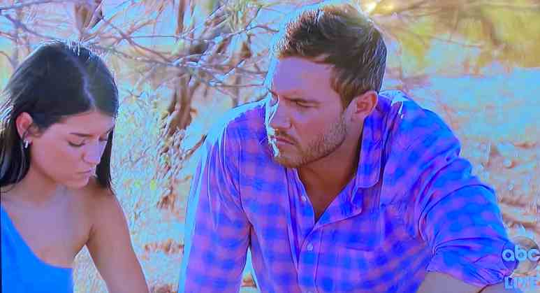 The Bachelor's Peter Weber and finalist Madison sit and converse outside