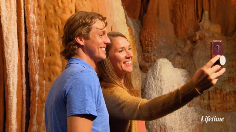 Jessica and Austin take a selfie in a cave