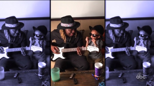 Jovin Webb and his son singing together