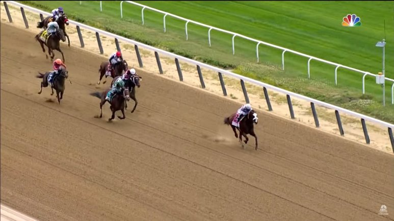 Five horses race in the final seconds of the Belmont.