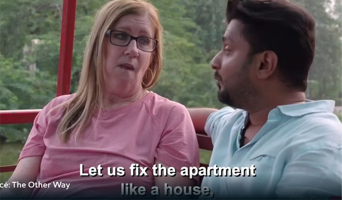 sumit and jenny sitting on a boat and sumit saying let's fix up the apartment