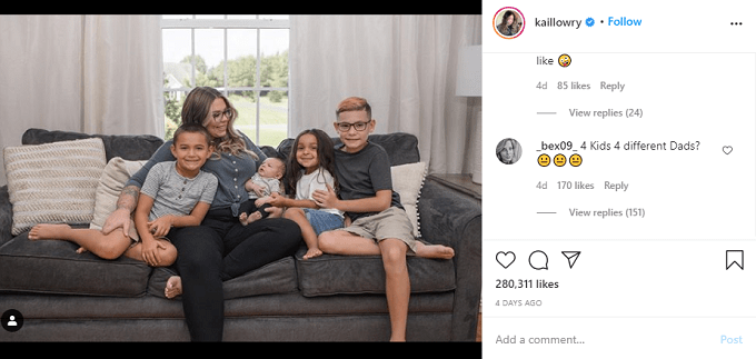 Kailyn Lowry sitting on the couch with her four sons
