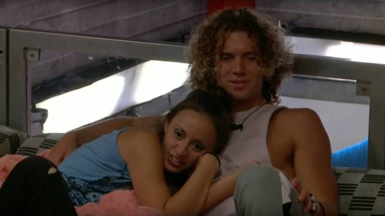 Kaitlyn Herman lies in Tyler Crispen's arms.