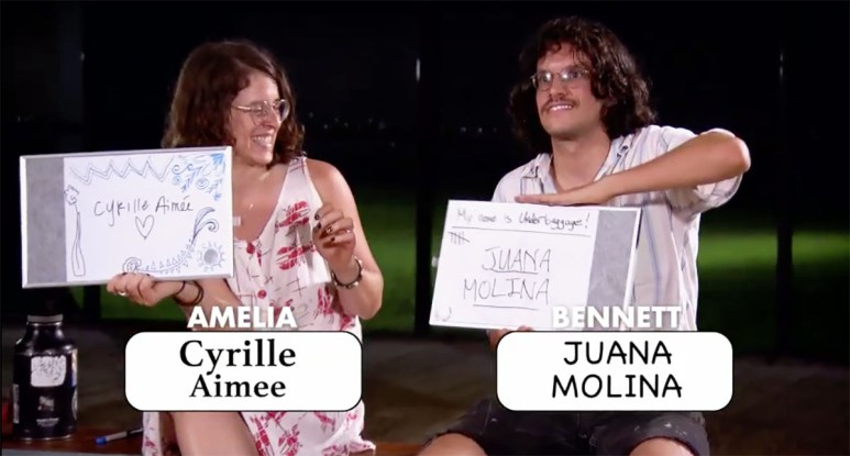 MAFS Bennett and Amelia holding up signs with celebrity crush names