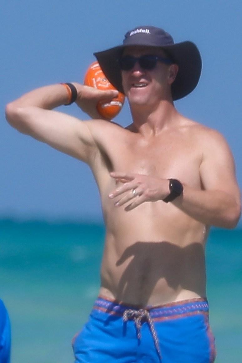 Shirtless Peyton Manning at the beach