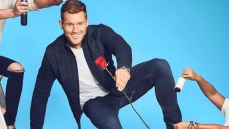 Colton Underwood pretending to jump over a fence on the cover of his new book