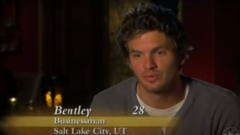 Bentley Williams wearing a gray shirt and talking in a confessional