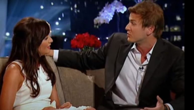 Jillian Harris sits on a tan couch with a contestant on The Bachelorette