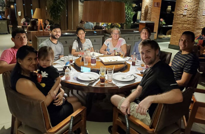 Paul ad Karine have dinner with her famil.