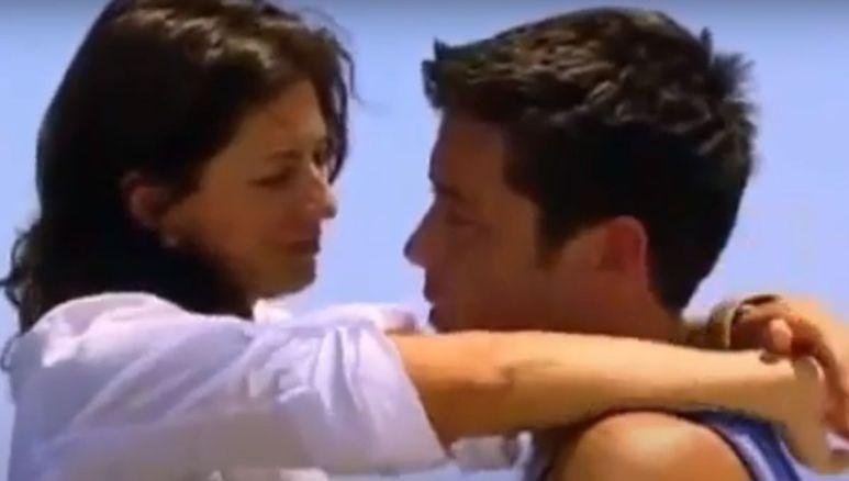 Ed Swiderski and Jillian Harris hug in front of the water
