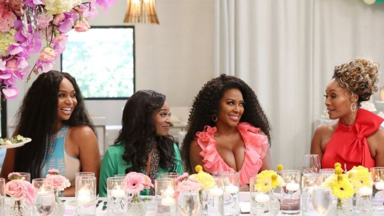 A source has revealed that RHOA filming is on lockdown after crew member diagnosed with COVID-19