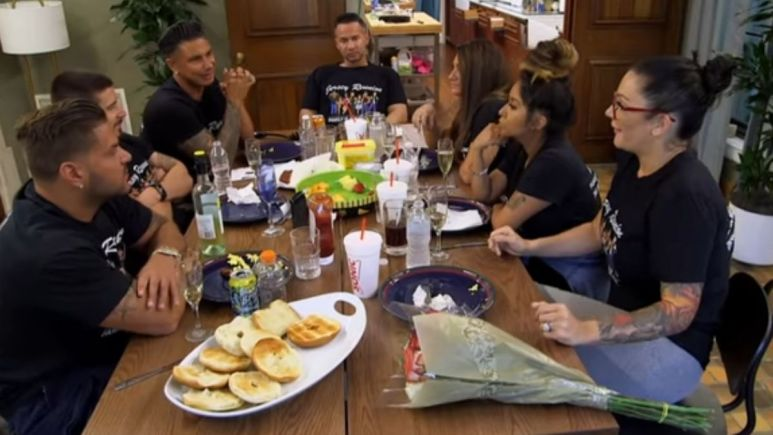 The cast of Jersey Shore Family Vacation during a family dinner