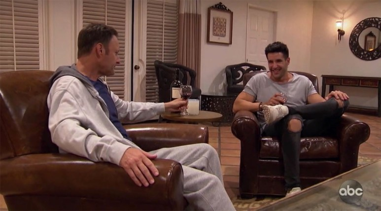 The Bachelorette Chris Harrison sharing a glass of wine with contestant Ed