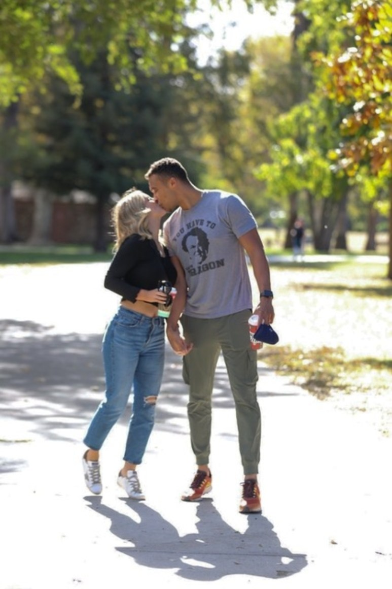Clare Crawley and Dale Moss kiss while on a walk through McKinley Park in Sacramento