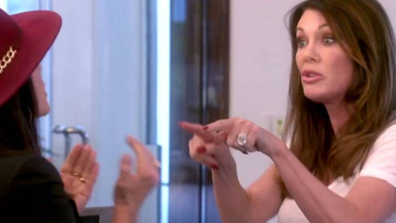 Lisa Vanderpump points at Kyle Richards as they fight while filming RHOBH.