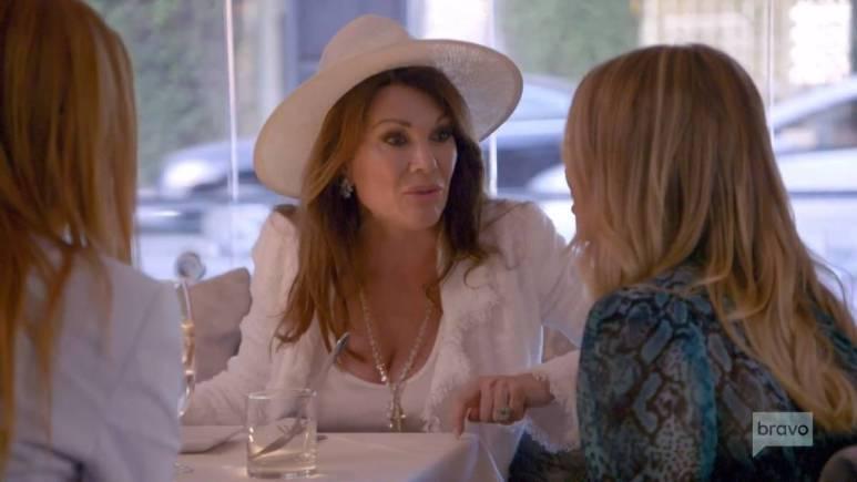 Lisa Vanderpump talks to Stassi Schroeder while filming Vanderpump Rules.