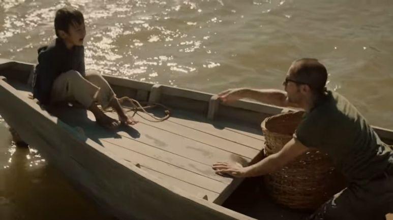 Nicky and a boy on a boat