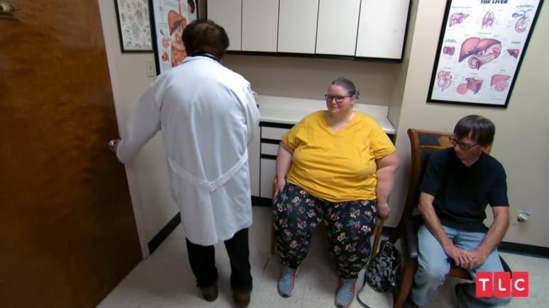 Dr. Nowzaradan leaves his office with a patient sitting in the chair in an episode of My 600lb Life.
