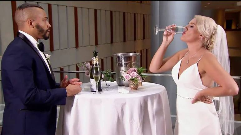 MAFS Season 12 couple Ryan and Clara having champagne on wedding