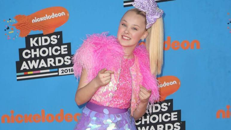 Jojo Siwa walks the red carpet for the Kids Choice Awards.