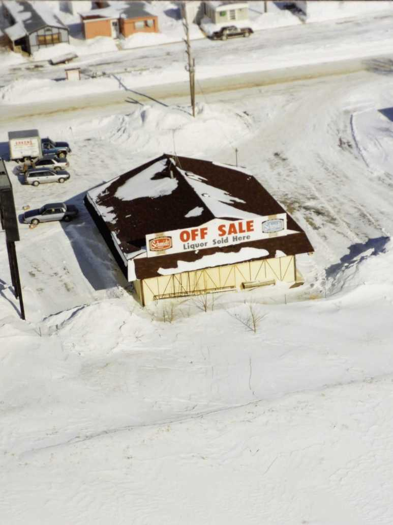 Aerial shot of theFreeway Liquor store, seen in snow.