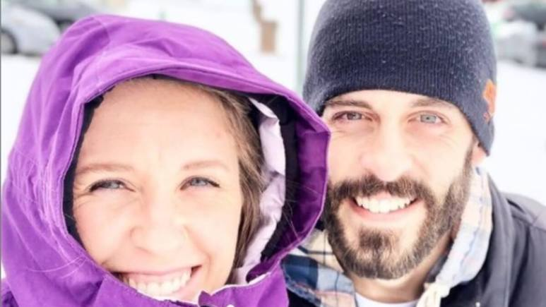 Jill Duggar and Derick Dillard outside in the cold.