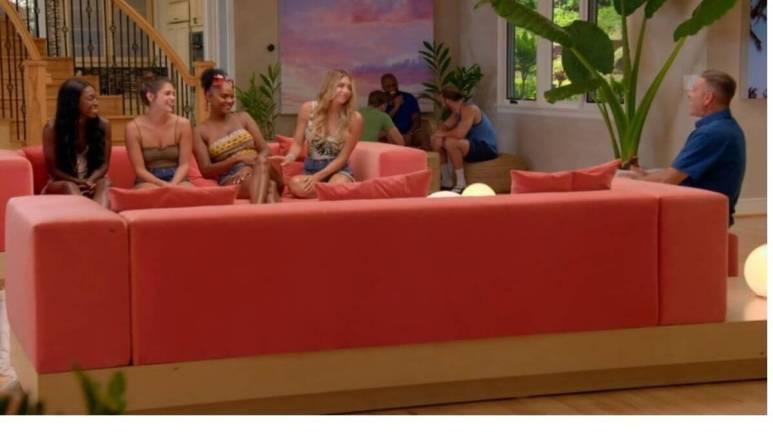 Mark Walberg tells the women about the next elimination on Temptation Island