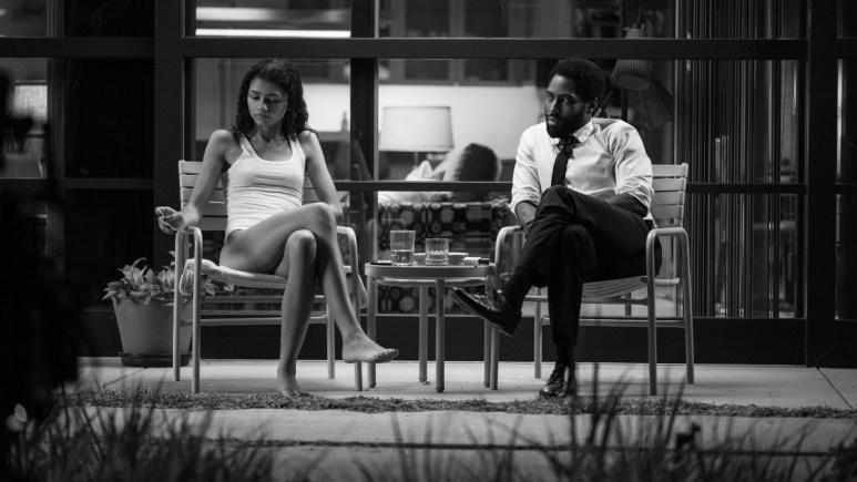 Zendaya and John David Washington sitting outside in Malcolm & Marie