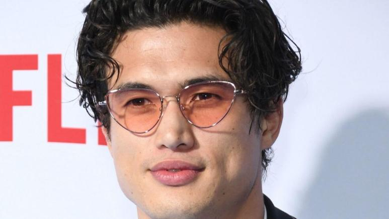 Image of Charles Melton at a press event.