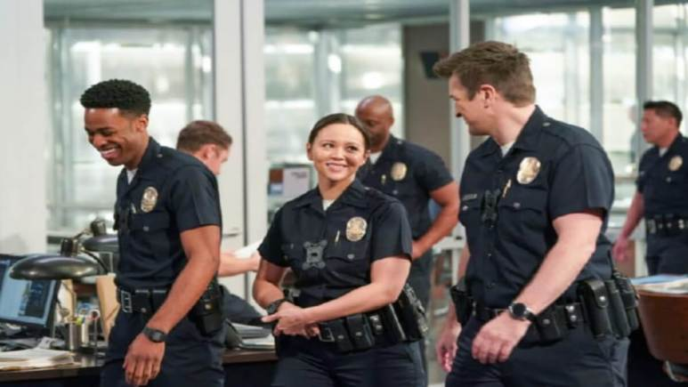 Nathan Fillion, Melissa O'Neill, and Titus Makin on the set of The Rookie
