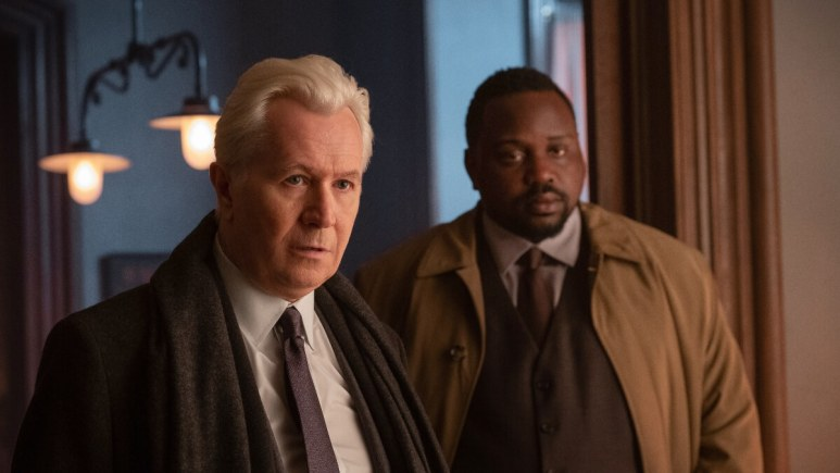 Gary Oldman and Brian Tyree Henry in The Woman in the Window.