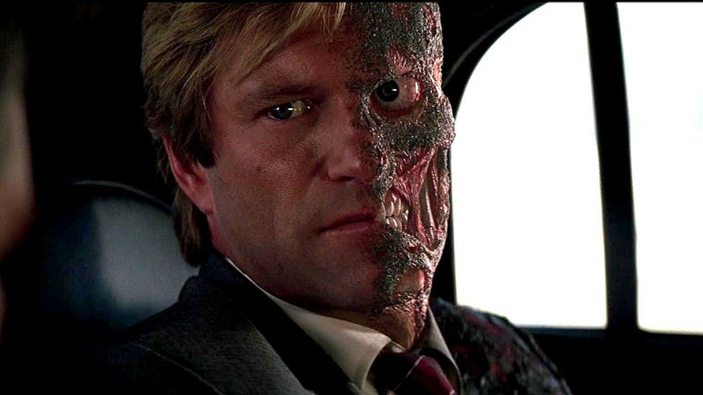 Two Face sitting in his car in The Dark Knight