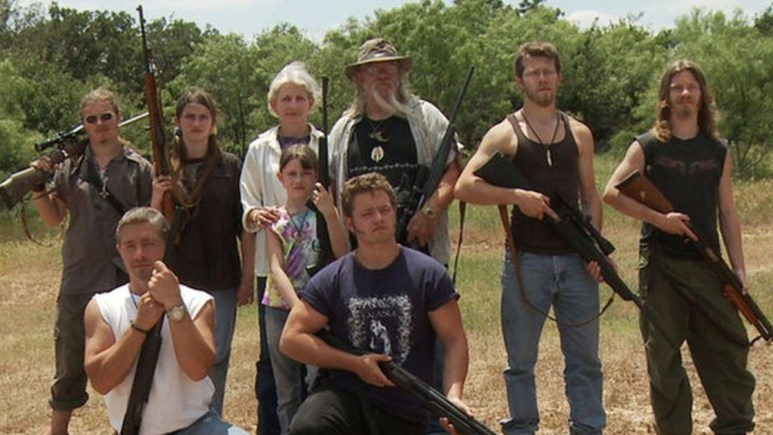 The Brown family posing with guns in Alaska.