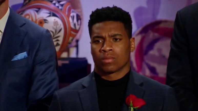 Andrew Spencer has a serious expression during the rose ceremony