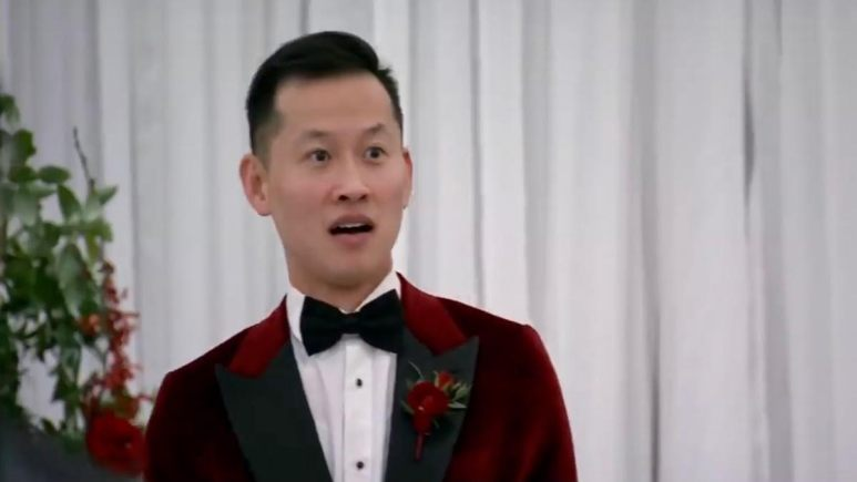 Johnny wears a deep red suit at the altar