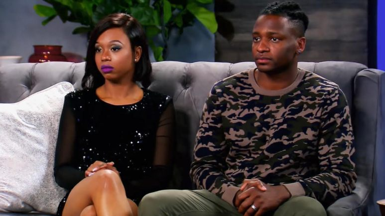 Shawniece and Jephte sit with their hands folded on the couch