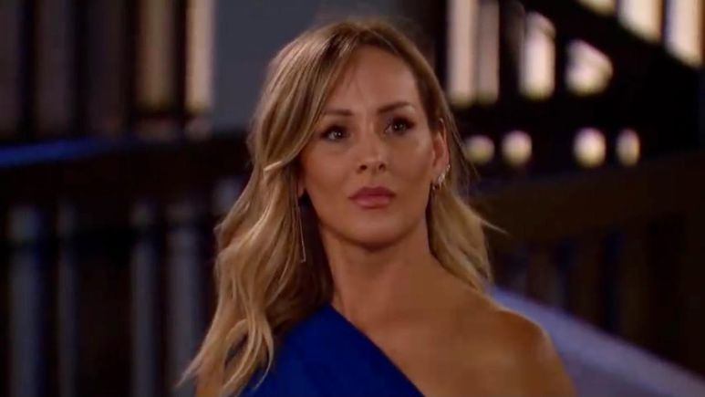 Clare Crawley wears a blue one shoulder dress at night