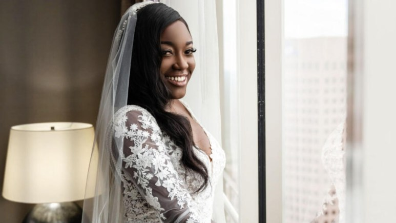 Paige Banks smiles in her wedding dress