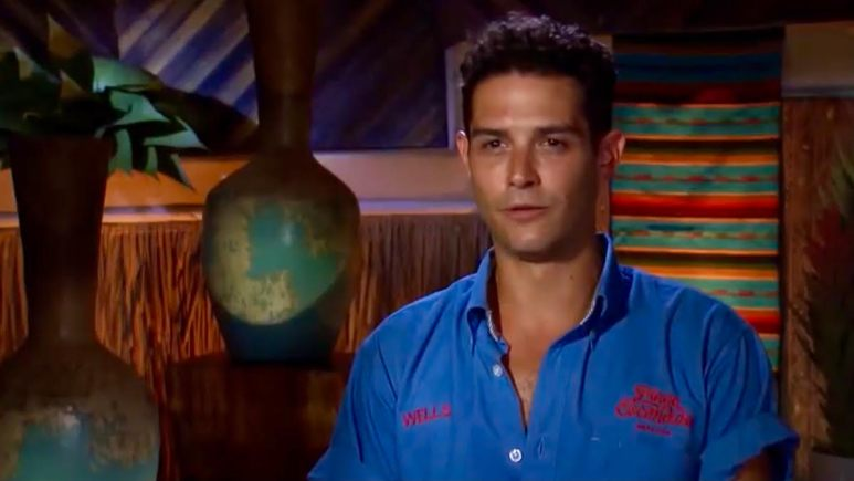 Wells Adams stares at the camera in his bar polo
