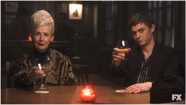 Frances Conroy as Belle Noir and Evan Peters as Austin Somers, as they appeared in Episode 1 of FX's American Horror Story: Double Feature