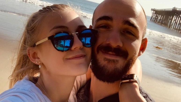 Brian Laundrie and Gabby Petito photographed on a beach