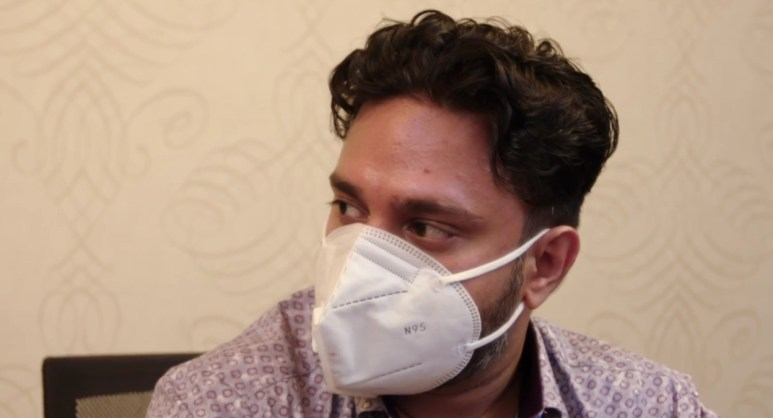 Sumit wearing a mask.
