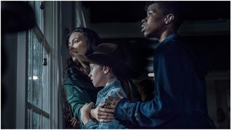 Christian Serratos as Rosita, Cailey Fleming as Judith, and Angel Theory as Kelly, as seen in Episode 8 of AMC's The Walking Dead Season 11