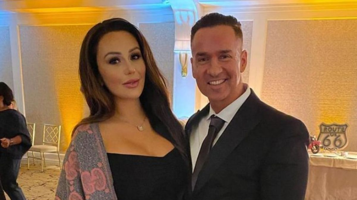 Jenni Farley and Mike Sorrentino dressed in fancy clothes at a wedding