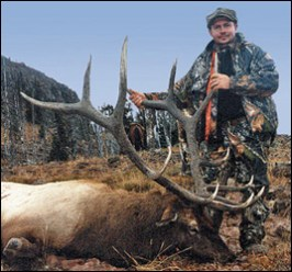 Hunter with bull elk scoring 346 Boone & Crockett taken in the Absaroka-Beartooth Wilderness.
