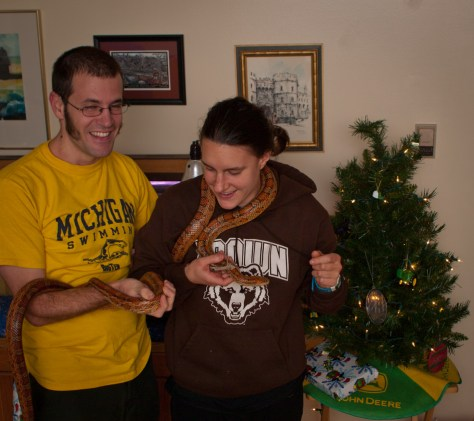 Allison and I pose for Christmas photographs.  I'm holding 1.