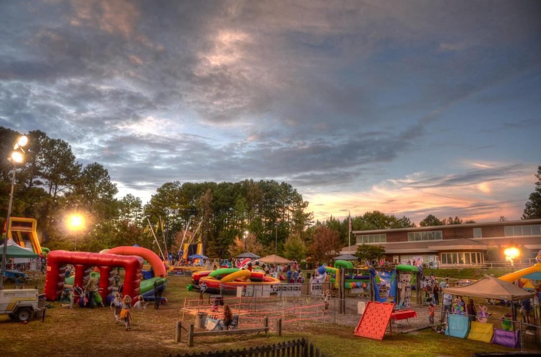 new school montessori center fall festival 2014 bouncy houses games children families