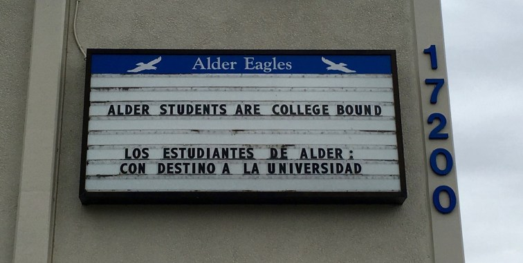 """School sign reading """"Alder Students Are College Bound"""" and """"Todos Estudiantes De Ader Son Destino A La Universidad"""