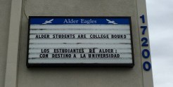 "School sign reading ""Alder Students Are College Bound"" and ""Todos Estudiantes De Ader Son Destino A La Universidad"